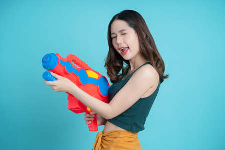 Asian woman using water guns playing songkran festival, isolated background. Banco de Imagens - 166003519