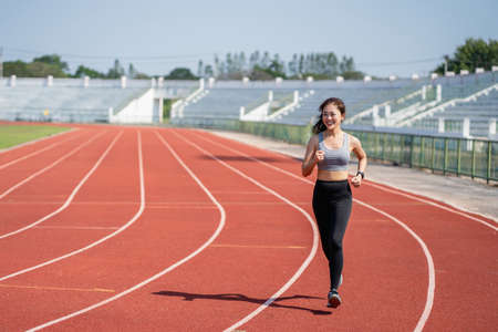 Asian woman runners she exercises in the morning. She is training for running. Sports and health concept.
