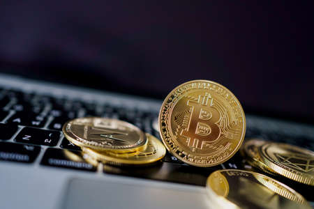 Photo Golden Bitcoins On laptop. Trading Concept Of Crypto Currency.