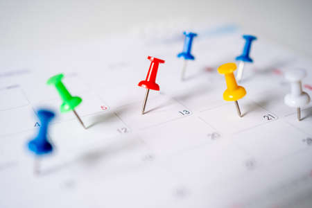 Push pins on calendar, mark the Event day with a Pin. Idea concept of to do planning.