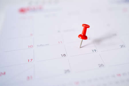 Calendar with a red pin on the 19th, mark the date of the event with a pin.