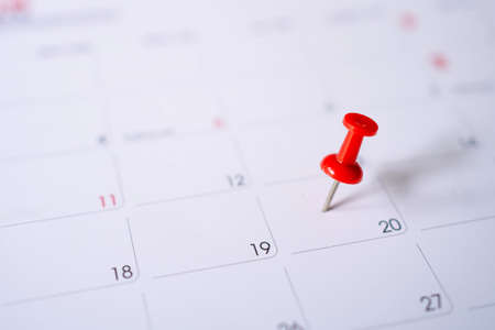 Calendar with red pins on the 20th, mark the date of the event with a pin.