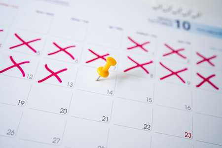 Calendar with yellow pins on February 14 is the day of love.
