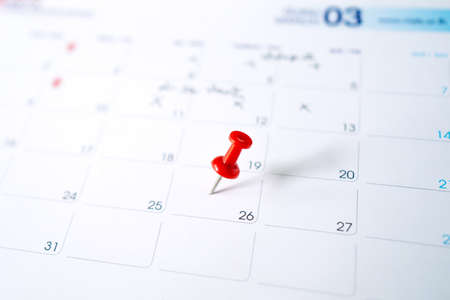 Selective focus. A photo of a calendar with a red pin on March 26.  Concept of to do planning.