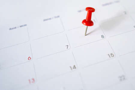 Calendar with a red pin for June 8th, mark the date of the event with a pin. Selective focus. Banco de Imagens