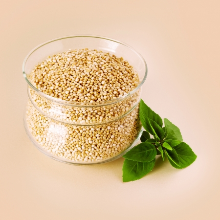White quinoa in a glass pot and green basil Stock Photo - 17775857
