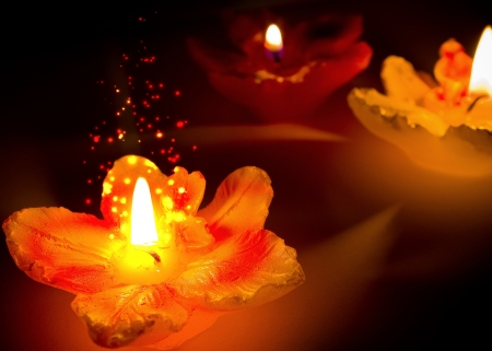 Three flower shape candles with sparks