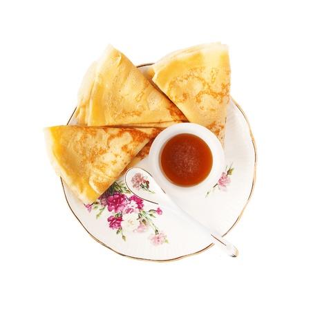 Triangles of slim pancakes with honey  Stock Photo