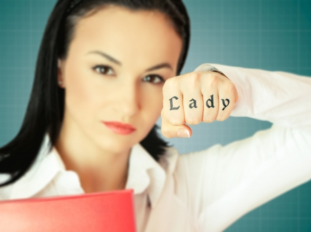 Young businesswoman image with focus on her hand showing tatoo Stock Photo - 19167799