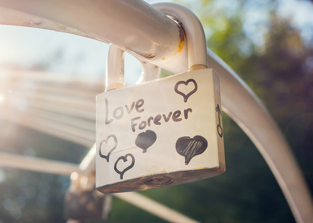 Love forever padlock with lens flare