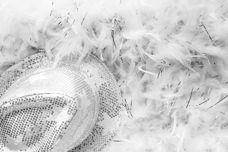 Black and white style party background with white sequins hat and feather boa Stock Photo