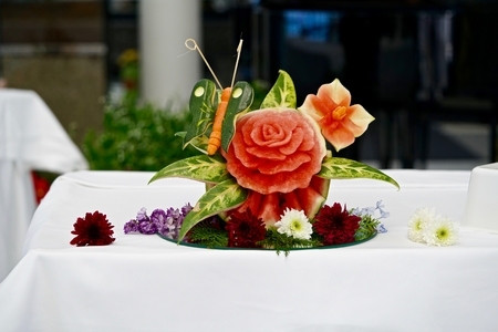zucchini: decoration composed of melon, zucchini, carot and flowers