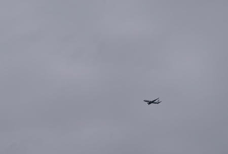 vacancies: airplane flying in the cloudy sky