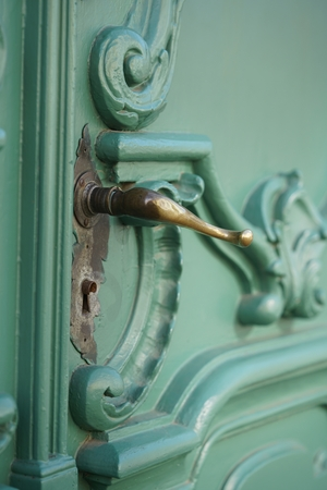 door knob: closeup of a door knob at a green historical door