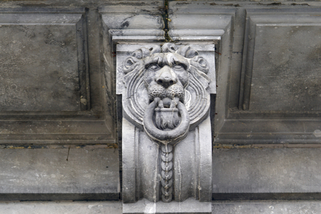 ancient architecture: view of a lion as a stone relief