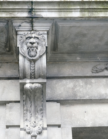 ancient architecture: relief of a grey lion head