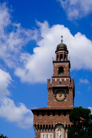 sforza: red steeple in Milan in front of a blue sky