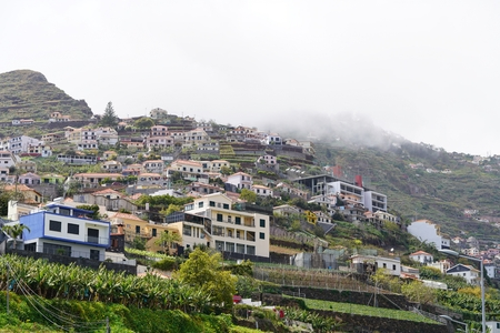 lobos: houses under the typical fog above Madeira