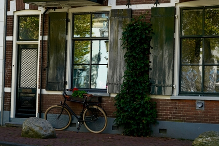 dutch typical: typical Dutch bike in front of some windows of a home