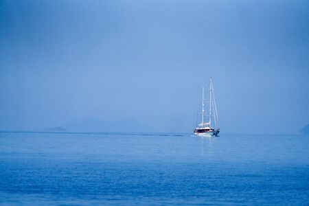 Big sailing boat on the blue ocean and under a blue sky Stok Fotoğraf - 129983305