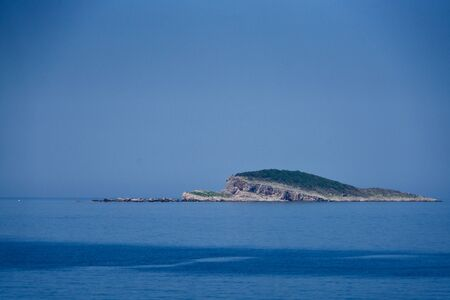 Green island in the blue ocean