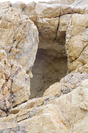 Open hole, a big stone in front