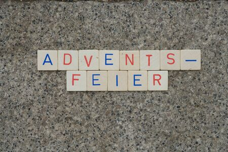 Close-up of the German word Adventsfeier (Advent celebration) in single wooden letters