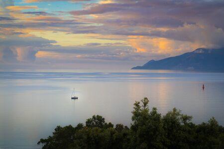 loneley boat on the sea under an evening sky Stok Fotoğraf