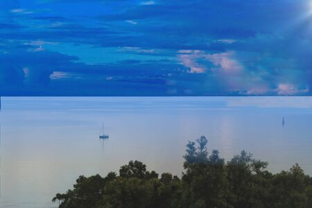 Lonely boat on the sea under a blue dawn sky Banco de Imagens