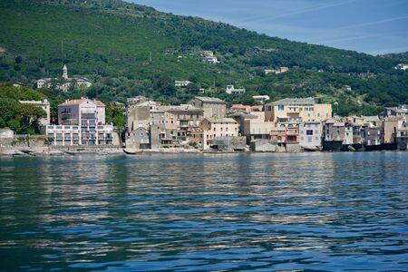 houses of Brando, Corsica, mirroring in the sea