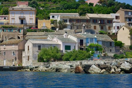 Corsican old colored houses at the blue sea Reklamní fotografie