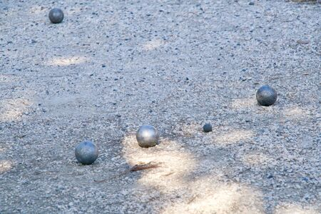 Close-up of some balls of a Boules game