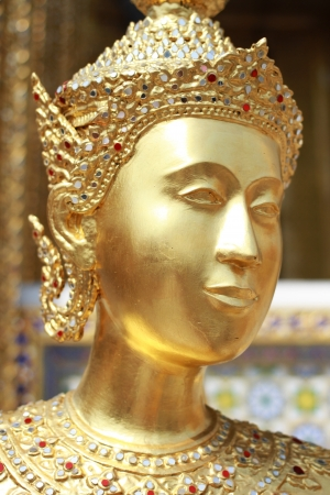 Golden Angel with Pagoda in Emerald Buddha temple Wat Pra Kaeo , Bangkok, Thailand photo