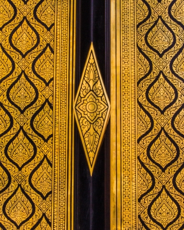 grand pa: pattern by Thia style on the wall and windows at the temple of emerald Buddha Bangkok Thailand Stock Photo