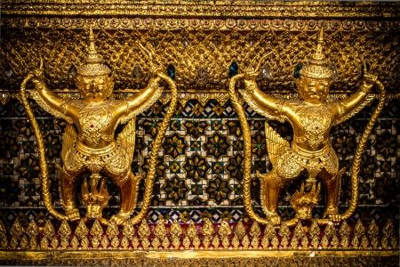 grand pa: The statues of Krut battling naga serpent and thai art architecture , a Thai Buddhist adaptation of Garuda in Emerald Buddha temple(Wat phra kaew) and Royal Grand Palace ,Bangkok,Thailand.
