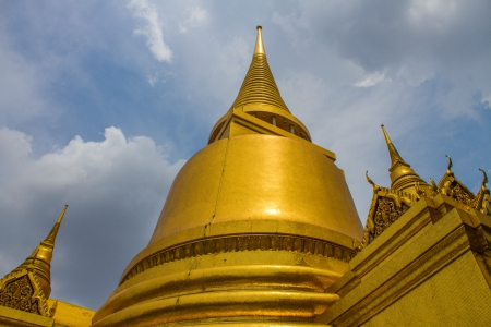 The beautiful of  golden pagoda of the Emerald Buddha temple(Wat phra kaew) and Royal Grand Palace ,Bangkok,Thailand. Stock Photo