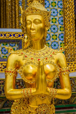 kaew: Golden angel statue of the Emerald Buddha temple(Wat phra kaew) and Royal Grand Palace ,Bangkok,Thailand.
