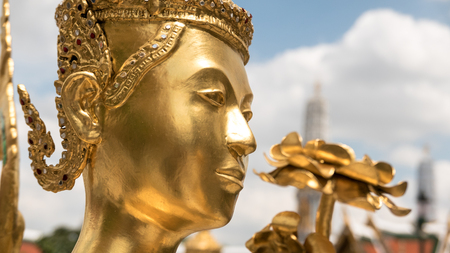 kaew: The face golden angel statue of Temple of the Emerald Buddha (Wat pra kaew) and Grand palace ,Bangkok,Thailand. Stock Photo