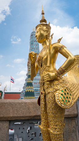 Golden angel statue of the Emerald Buddha temple(Wat phra kaew) and Royal Grand Palace ,Bangkok,Thailand.