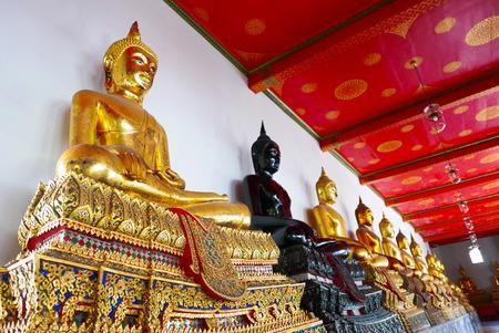Buddha gold statue and thai art architecture in Wat Phra Chetupon Vimolmangklararm (Wat Pho) temple in Thailand. Editorial