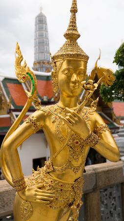asian angel: Golden angel statue of the Emerald Buddha temple(Wat phra kaew) and Royal Grand Palace ,Bangkok,Thailand.