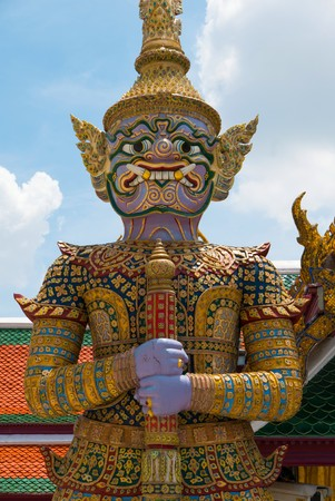 kaew: The beautiful of  giant  smile statue of the Emerald Buddha temple(Wat phra kaew) and Royal Grand Palace ,Bangkok,Thailand. Stock Photo