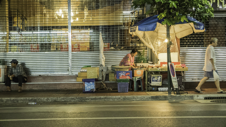 fruit trade: Night photo for fruiterer selling many types of fruit on china town (Yaowarat) Road,the main street in Chinatown, once of Bangkok landmark and important street for more foods very delicious for thai-chinese style. Photo taken on: 3 September  , 2016