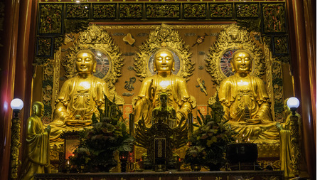 gold road: Bangkok, Thailand - September 3, 2016 : Three Buddha gold statue chinese style and chinese art architecture in Wat Leng Nei Yee Chinese temple in Yaowarat road,Bangkok capital city,Thailand.Photo taken on: 3 September  , 2016