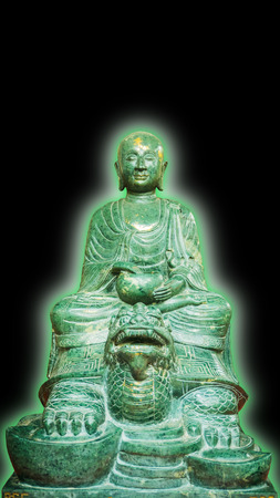 aura: Old Buddha stone green (Lucky stone)Statue Isolated with green aura on a black Background.