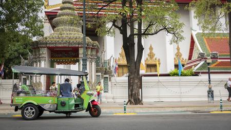 tuk: Bangkok, Thailand - SEPTEMBER 19, 2016 : Tuk Tuk taxi waiting customers on street at Wat Phra Chetupon Vimolmangklararm (Wat Pho) temple in Thailand. Editorial
