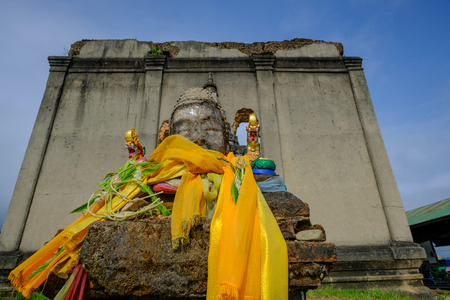 wiwekaram: A public ancient head Buddha statue left in the forest for hundred years in wiwekaram temple ,Sangkhaburi,Kanchaburi,Thailand.  Photo taken on: October 14, 2016 Editorial