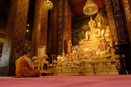 Bangkok - Thailand , October 30 - 2016: Picture of a buddhist monk meditating in Wat Bovoranives, Bangkok, Thailand. Photo taken on: October 30, 2016