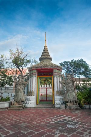 Bangkok, THAILAND - November 2, 2016 : Stone Thai-Chinese style sculpture and thai art architecture in Wat Phra Chetupon Vimolmangklararm (Wat Pho) temple, Thailand. Photo taken on: 2 November , 2016