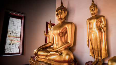 Buddha gold statue and thai art architecture in Wat Mahathat Yuwarat sa rit  temple in Thailand.